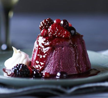 Individual summer puddings. A traditional, low-fat dessert with strawberries, raspberries, redcurrants, blueberries and blackberries set in mini basin moulds