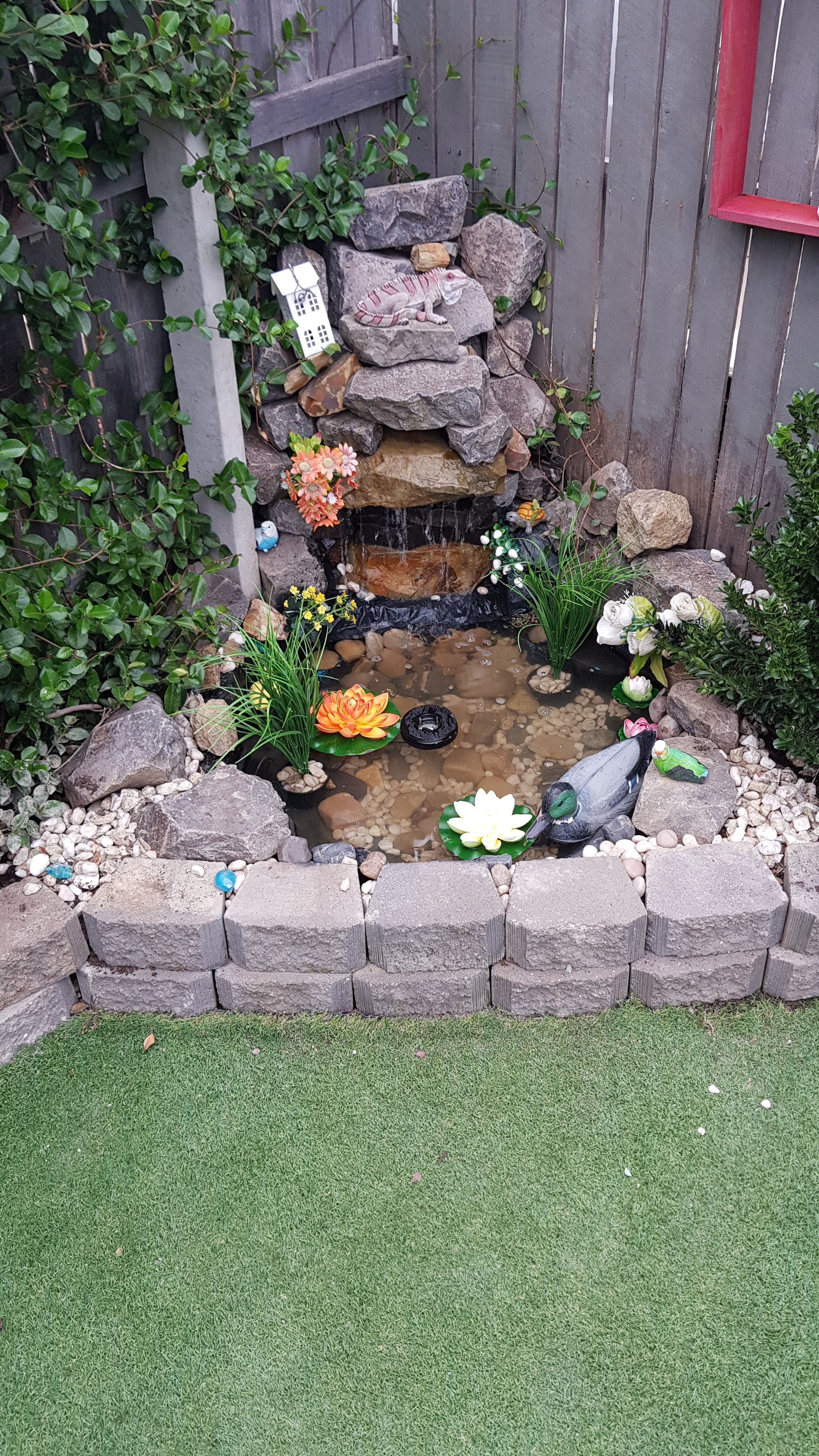 Garden corner rock waterfall ending in pond. The pond was ... on Rock Garden Waterfall Ideas id=66871