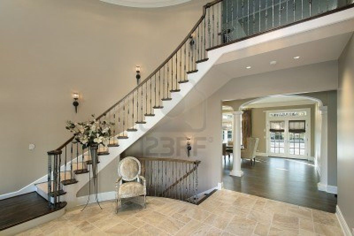 Foyer In Luxury Home With Curved Staircase   Images Of Modern Stairs Design  Ideas Interior And Building Plans