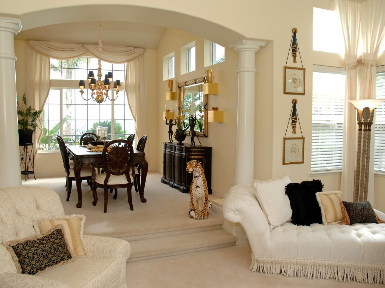 This Large Adjoining Living Room And Dining Area Is Separated By An Arched Entryway With