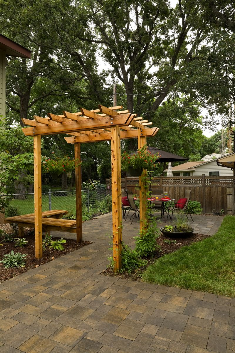 add a paver patio and seating bench to a small urban yard and