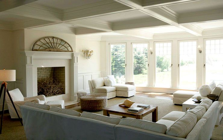Andrew Maier Interiors architectural interest on mantel, unadorned  windows.. fresh, clean style