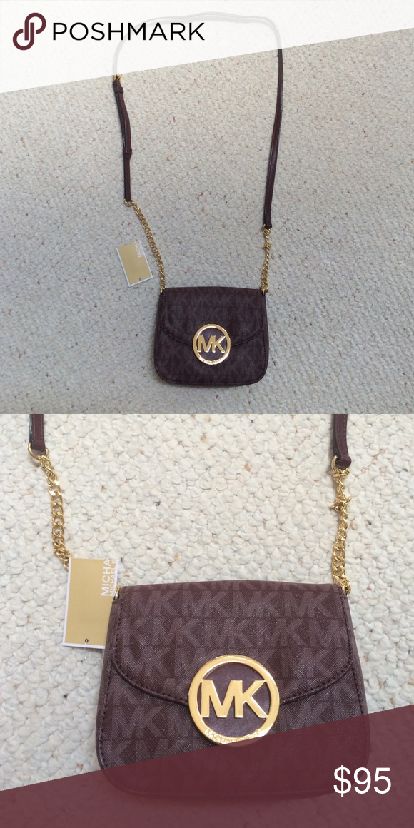 b5321e8df4c Tory Burch Charlie Mini Phone Cross Body Charlie Mini Phone Bag is a LIMITED  EDITION Made of leather