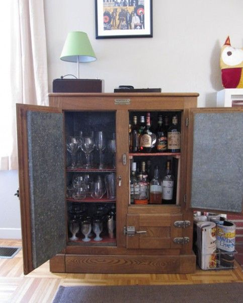 my parents have this antique refrigerator and turned it into a liquor cabinet years ago! Mom and Dad, this blog copied your idea! love it!!