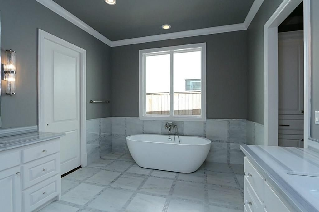 Large, relaxing master bathroom with freestanding tub resting on ...