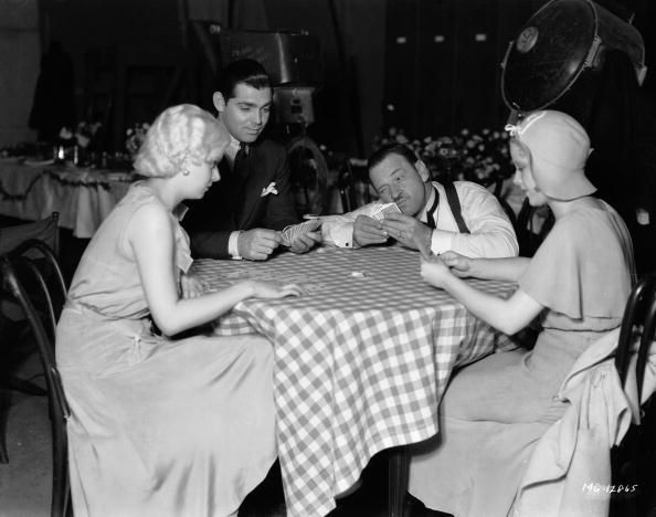 17th February 1931: Left to right : Jean Harlow, Clark Gable, Paul Hurst and Mary Carlisle playing cards in a scene from 'The Secret Six', directed by George W Hill.