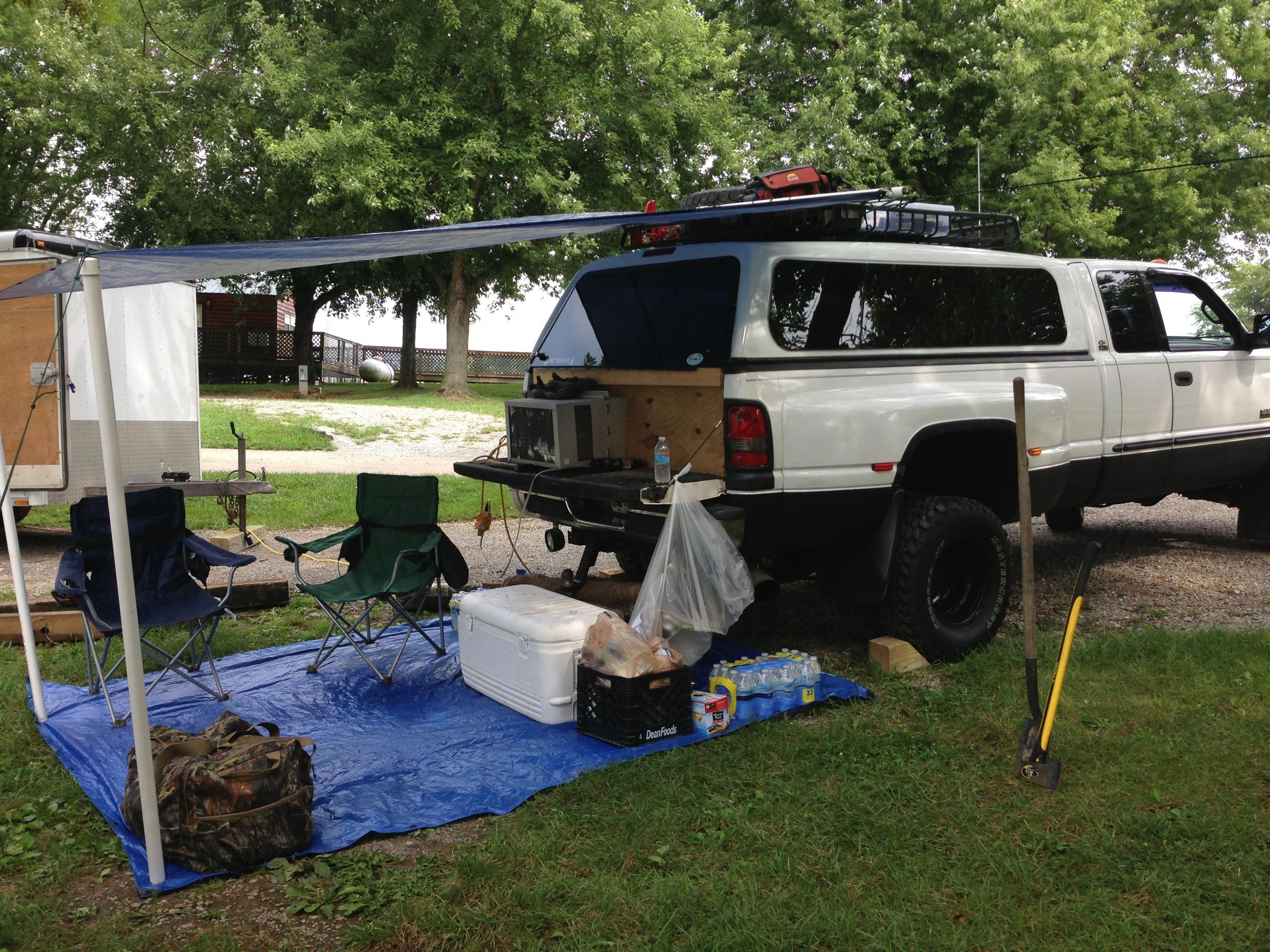 Truck camping. Air conditioner and queen size air mattress