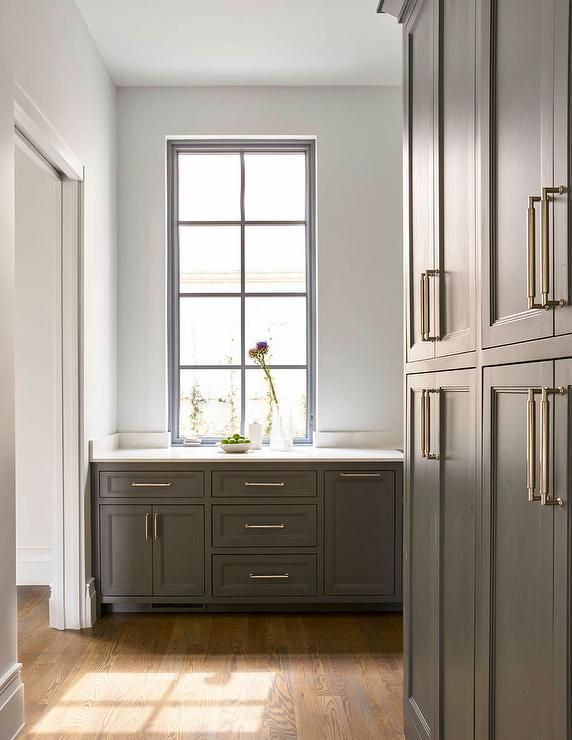 Best Sleek Gray Butler S Pantry Features Stacked Gray Cabinets 400 x 300