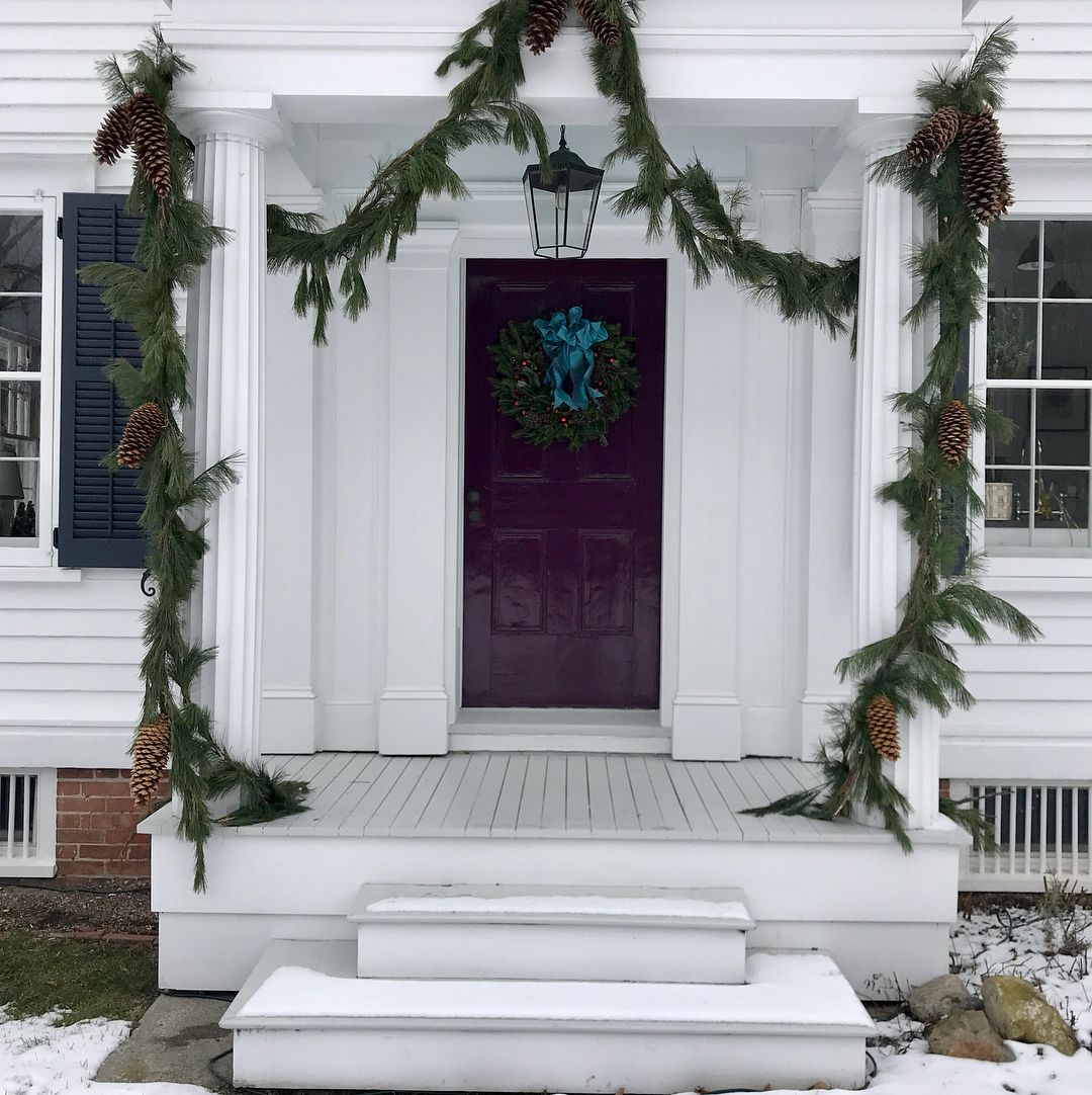 The front and side porches all in there Christmas dress! Expertly supervised @harryheissmann wreath and ribbons @plazaflowersnyc #clovebrookfarm #merrychristmas #itsthebesttimeoftheyear