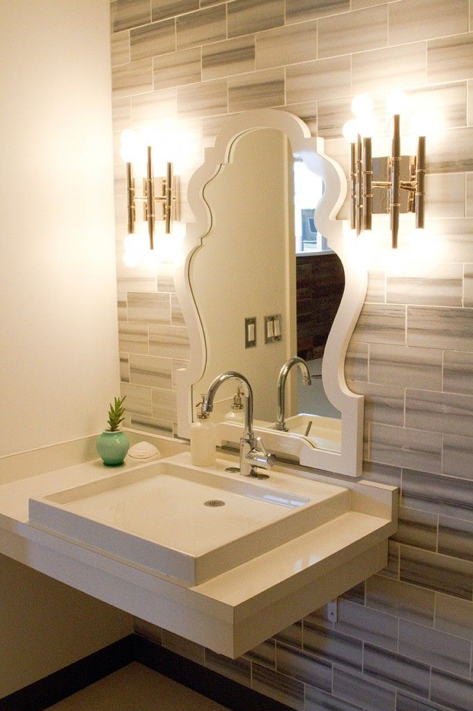 The neutral subway tiles are nice, as are the sconces and the sink ...