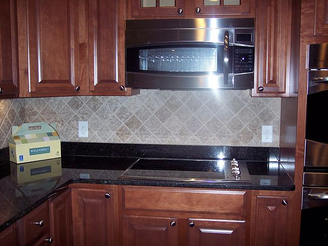 cabinets maple with a cognac glaze. granite is Ubatuba ... on What Color Granite Goes With Maple Cabinets  id=94437