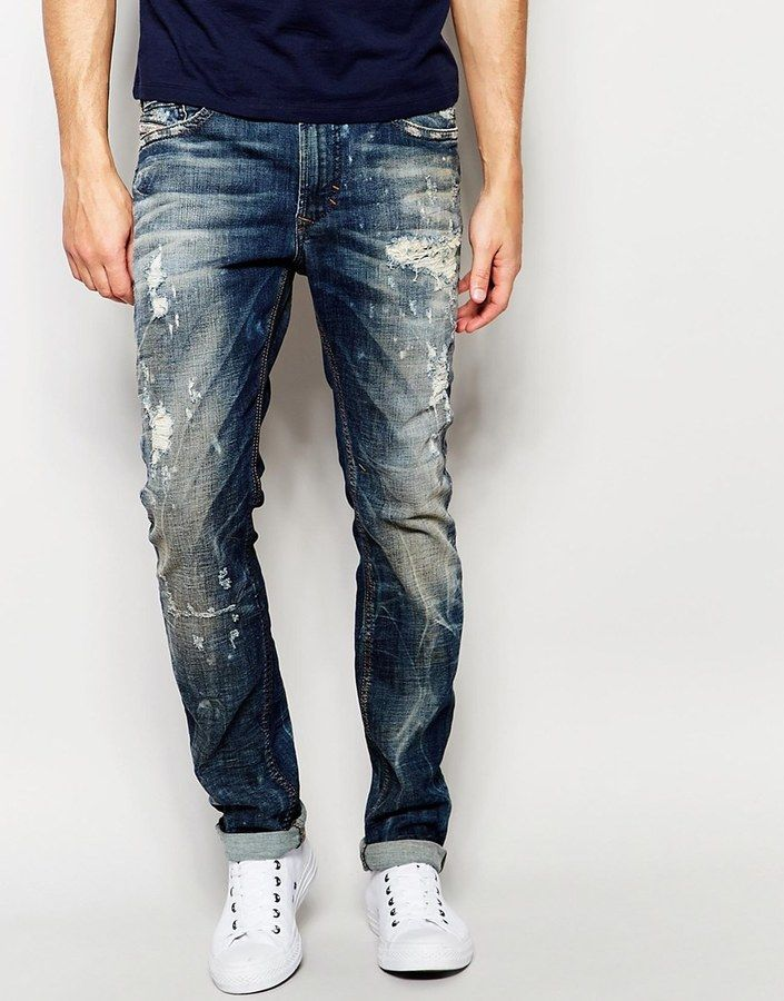 Shop Diesel Jeans Thavar DNA Slim Fit Stretch Extreme Rips Bleach at ASOS.