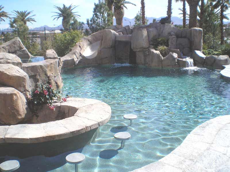 Swimming pool surprising natural pool designs with swim for Pool design with swim up bar