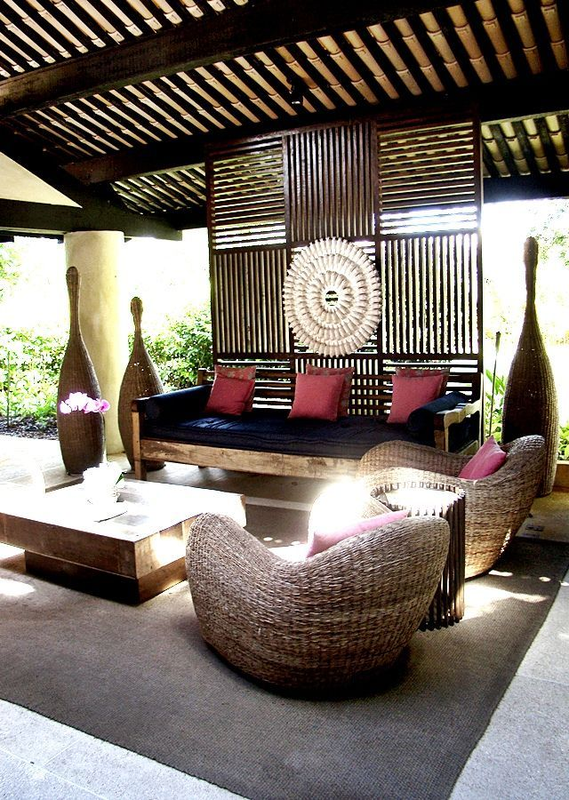 Love that it's outside yet secluded and covered. Looks like an outdoor living room.