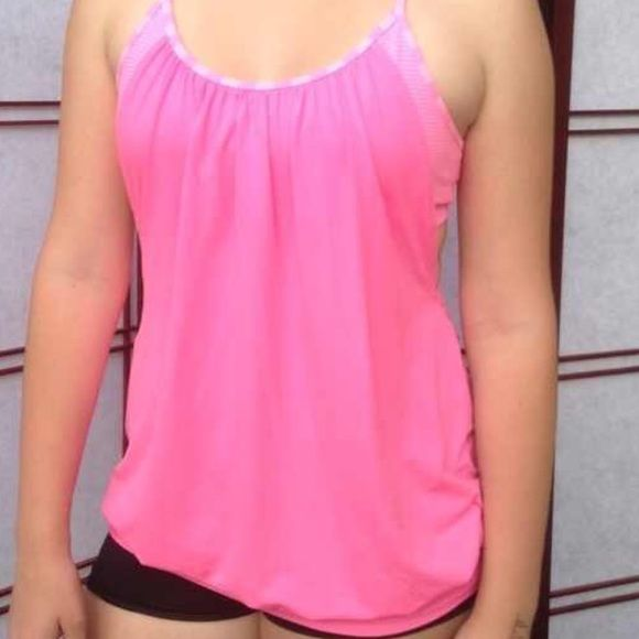 Pink LuLu Loose fitted tank, built in pink/wht bra Perfect workout tank, nice weather is coming  great for a run or even a Zumba/yoga class! In my opinion, this could fit a med or large (8, 10 OR 12!) very forgiving, super soft and in really good condition! ❤️ lululemon athletica Tops Tank Tops