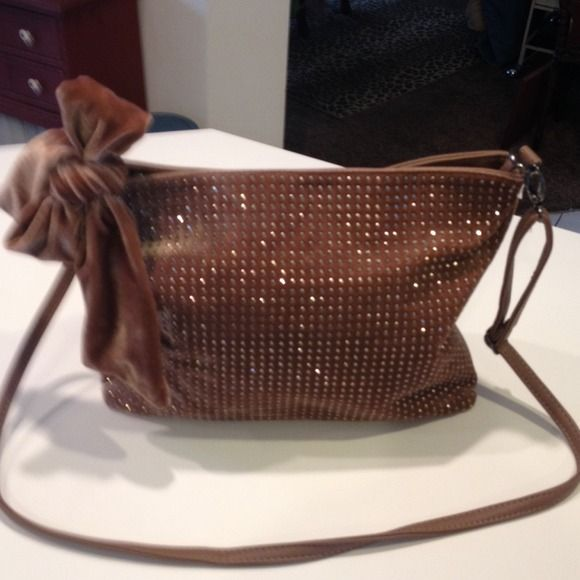 Beautiful Betsey Johnson crossbody bag Long adjustable strap tan leather on side other studed silver material with bow can be removed new without tag trade 200 Betsey Johnson Bags Crossbody Bags
