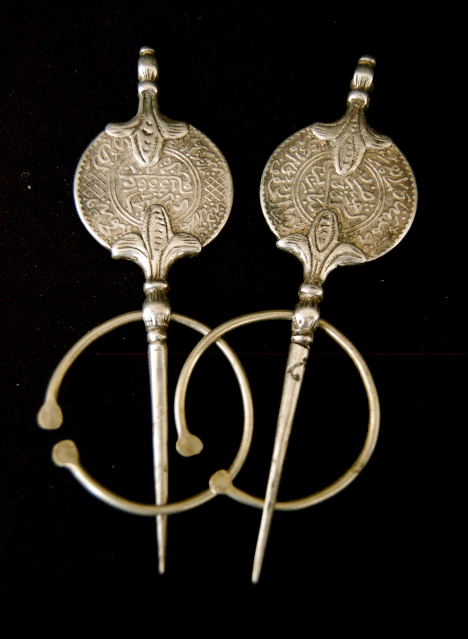 Pair of silver coin fibulas from Morocco