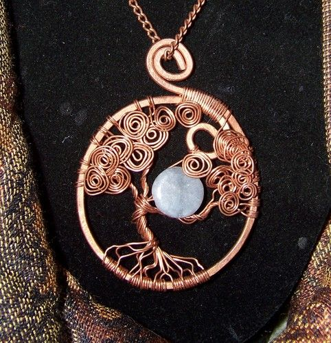Love the texture copper wire wrapped tree of life with moon bead