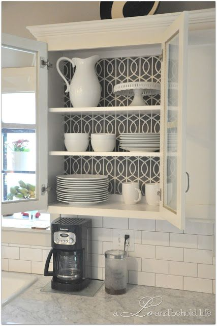 Line The Back Of Your Kitchen Cabinets With Fabric And Thumbtacks