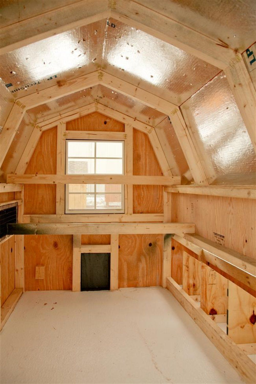 Here 39 s the interior of a dutch barn shaped chicken coop for Fancy chicken coops