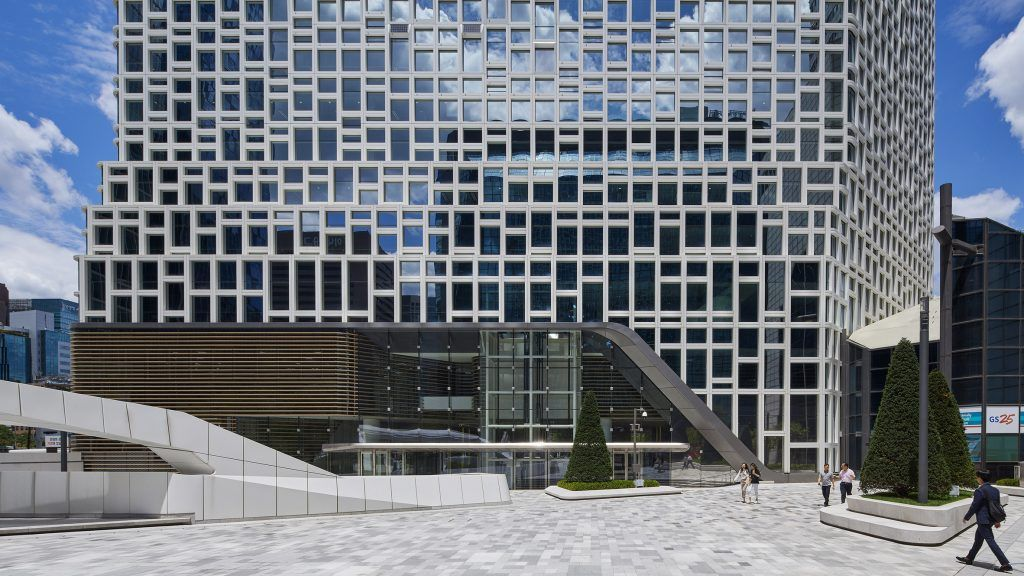 The Hanwha headquarters office tower in Seoul has been remodelled by Dutch architecture firm UNStudio, retrofitting its facade to hold solar panels.
