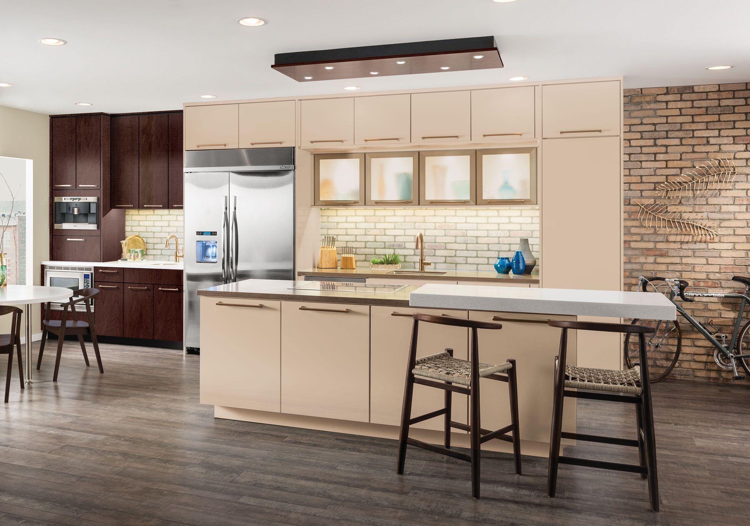 The Vetro Champagne Bronze Door takes center stage in this modern KraftMaid kitchen.