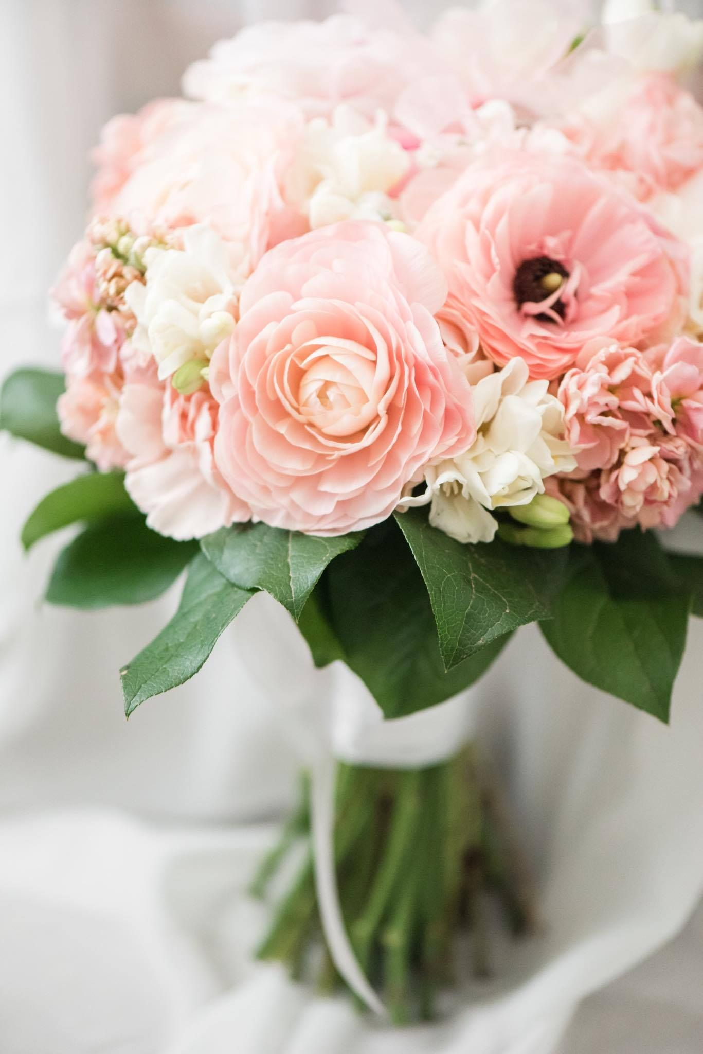 Bridal Bouquet In Pastel Colors With Ranunculus Roses Stock Carnations Freesia And Salal Flower Bouquet Wedding Carnation Flower Flowers