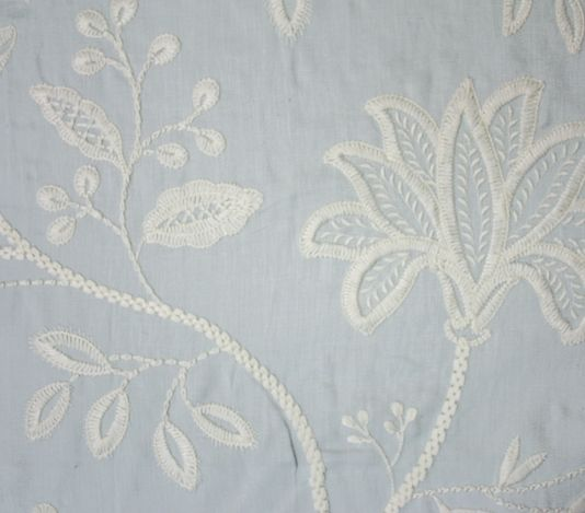 Larkhill Fabric A Pale Blue Embroidered With Large Sch Fl Design In White