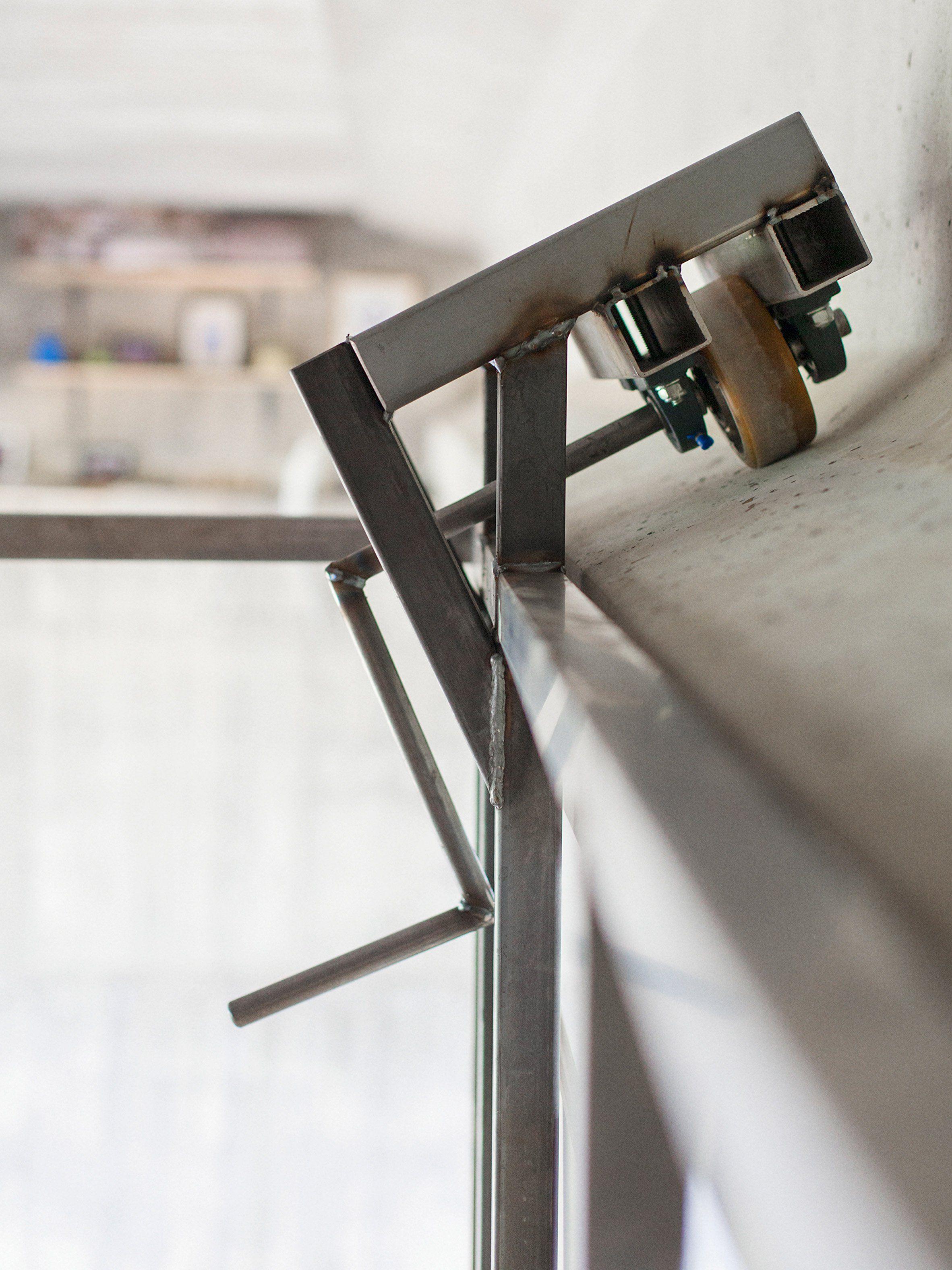 Fernando Abellanas Hangs Secret Studio Under A Bridge In Valencia - Designer builds a secret studio beneath a busy bridge in valencia