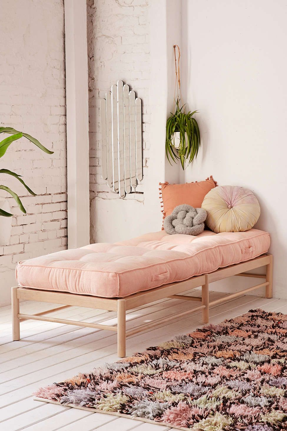 Calming bohostyle entryway with blush pink tufted cushion bench and