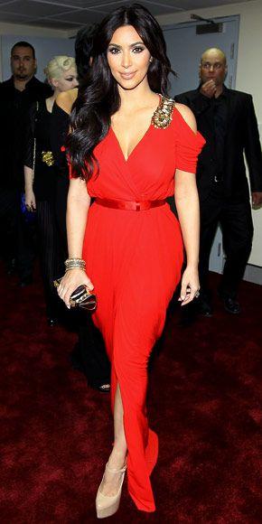 Kim Kardashian in red column dress with embellished straps ...