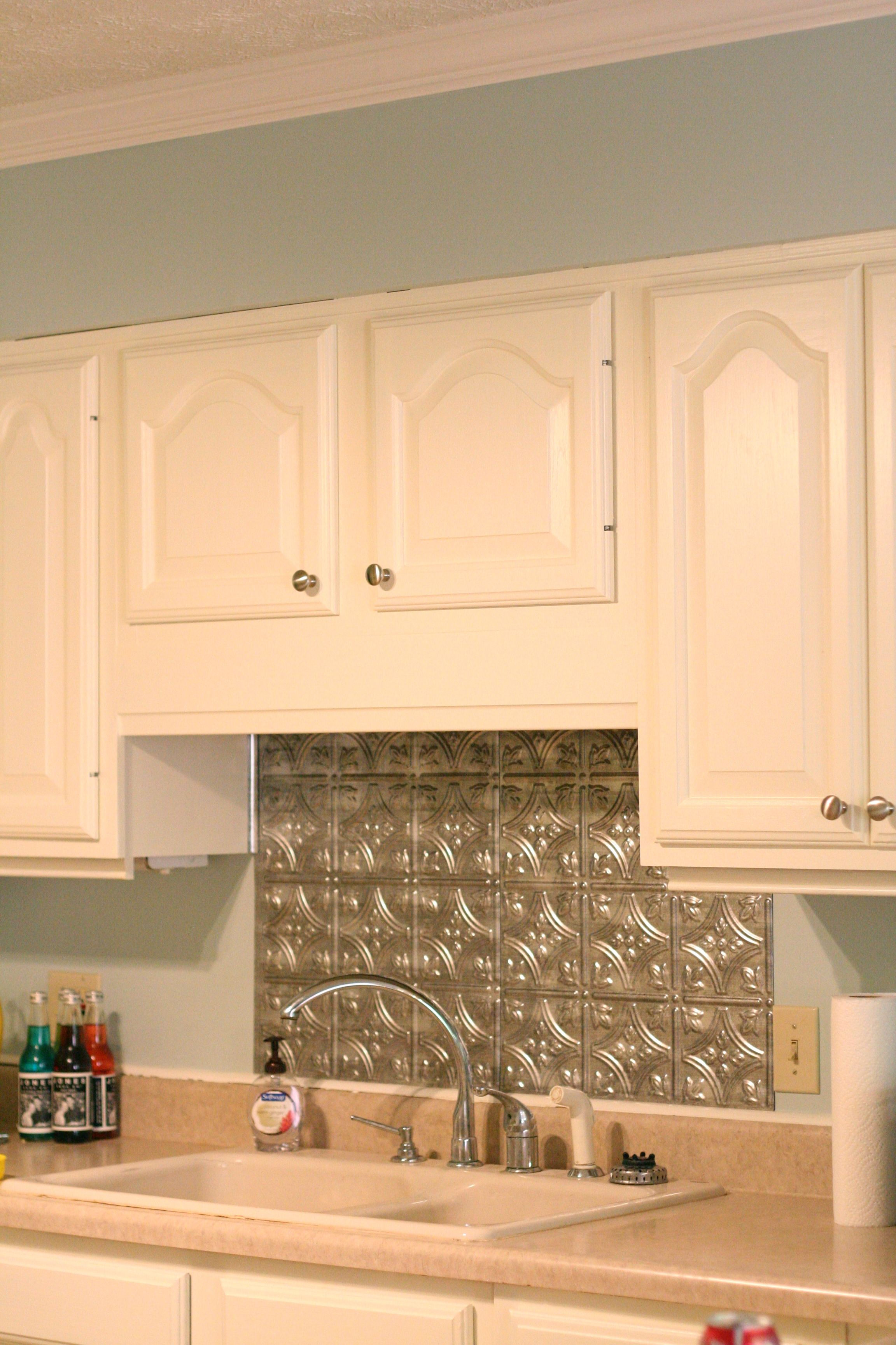 our new faux tin backsplash and newly painted cabinets and walls ...