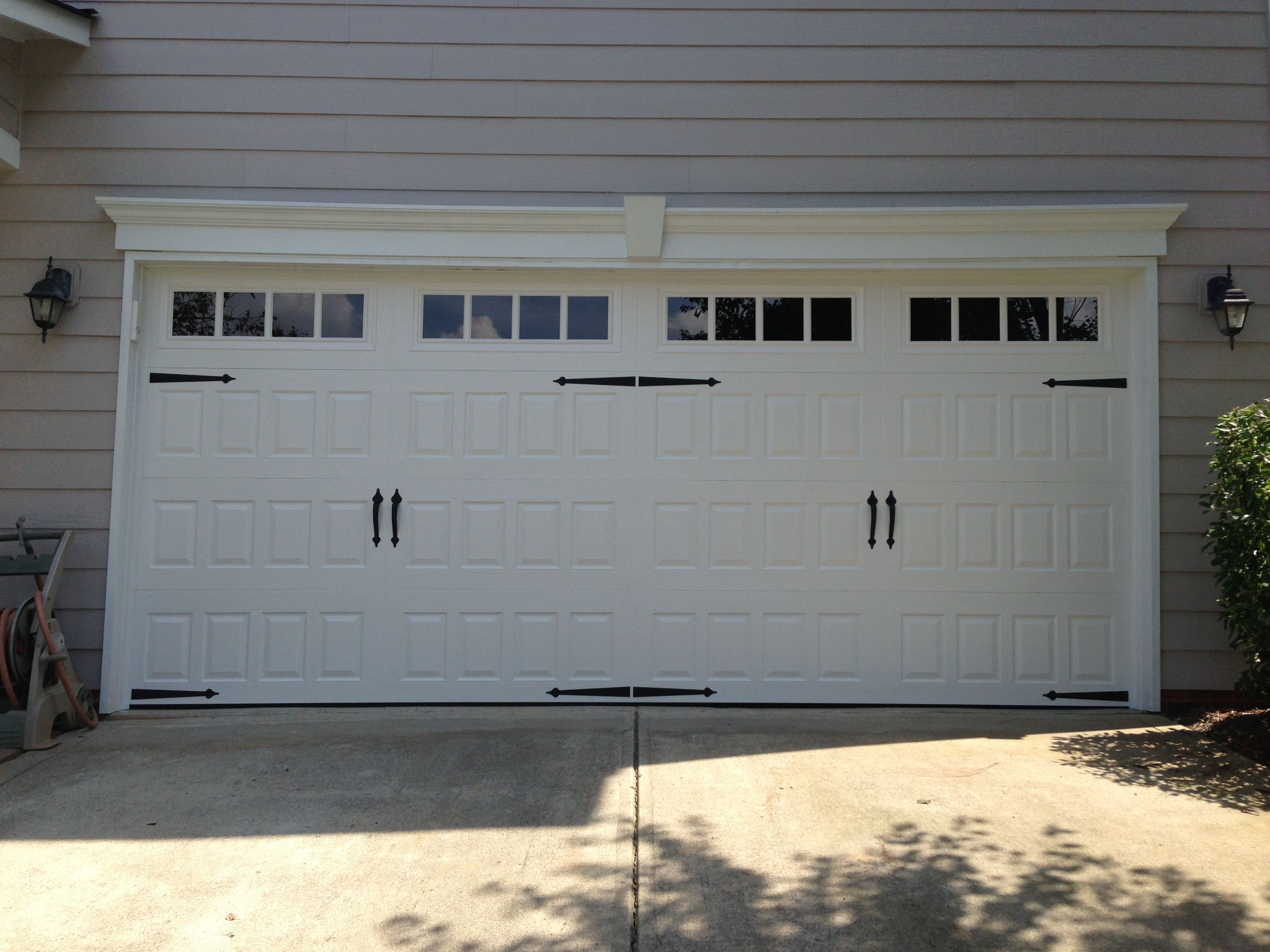 Carriage double garage door - Steel Raised Panel Carriage House Garage Door With Windows And Decorative Handles Hinges