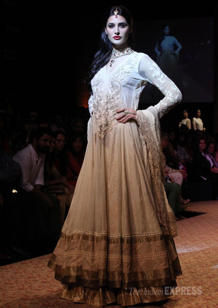 Lakme Fashion Week 2013: 'Madras Cafe' actress Nargis Fakhri looked regal and gorgeous as she walked the ramp for designer Ritu Kumar Monday at the ongoing Lakme Fashion Week (LFW) Winter/Festive 2013. (IE Photo: Amit Chakravarty)