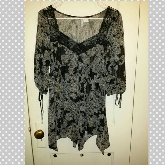 Semi-sheer black and white silky top. Semi-sheer black and white silky top. Has handkerchief hem, side ties on the sleeves and lace detailing. Gently used. lilly lou Tops