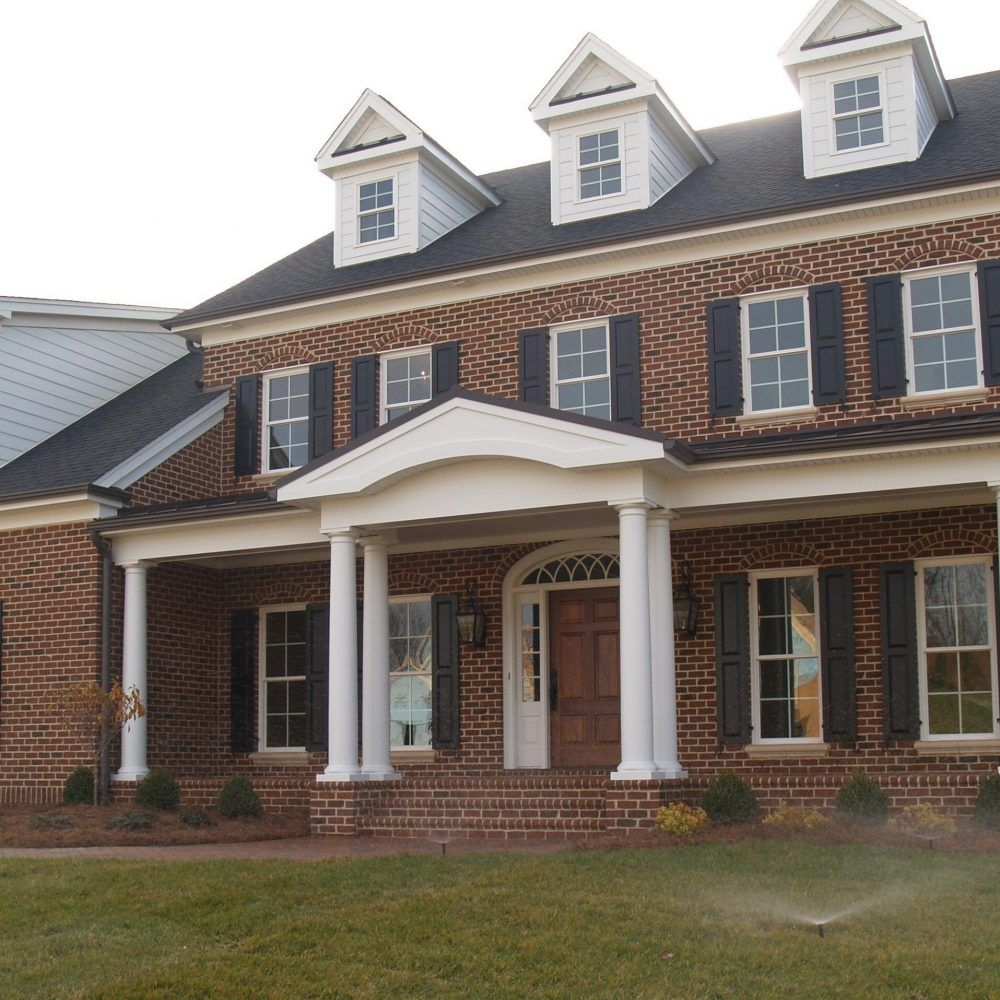 A timeless tradition red brick house with pine hall brick Black brick homes