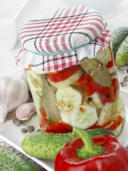 Preserve+the+tastes+of+summer+by+pickling+fresh+garden+veggies+in+homemade+spiced+pickling+vinegar.+Top+jars+with+colorful+fabric+or+paint+the+lids+with+chalkboard+paint+and+scribble+on+a+holiday+message.+Get+the+recipe.+