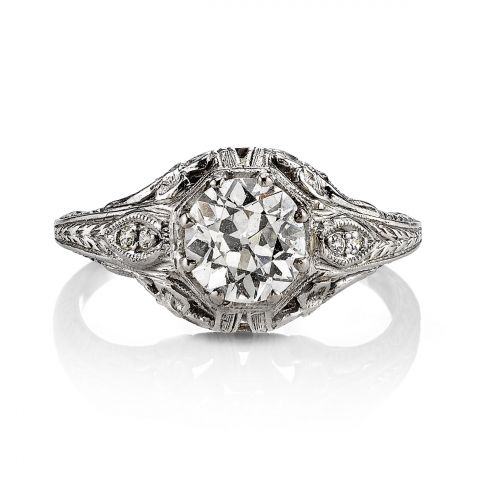 1.16ct J/SI2 GIA certified old European cut diamond set in a vintage platinum mounting. Circa 1930. An Edwardian design with filigree, engraving, and floral finishes.