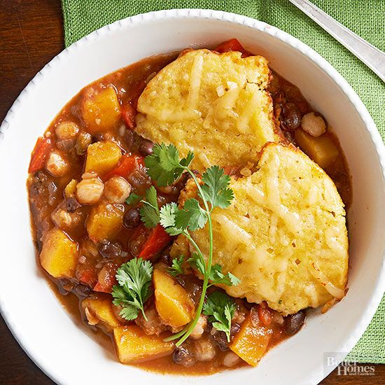 Bold Mexican flavor meets classic cold-weather ingredients in this blend of enchilada-sauced butternut squash and beans. Crumbly corn bread dumplings finish the slow cooker casserole with home-style flair./