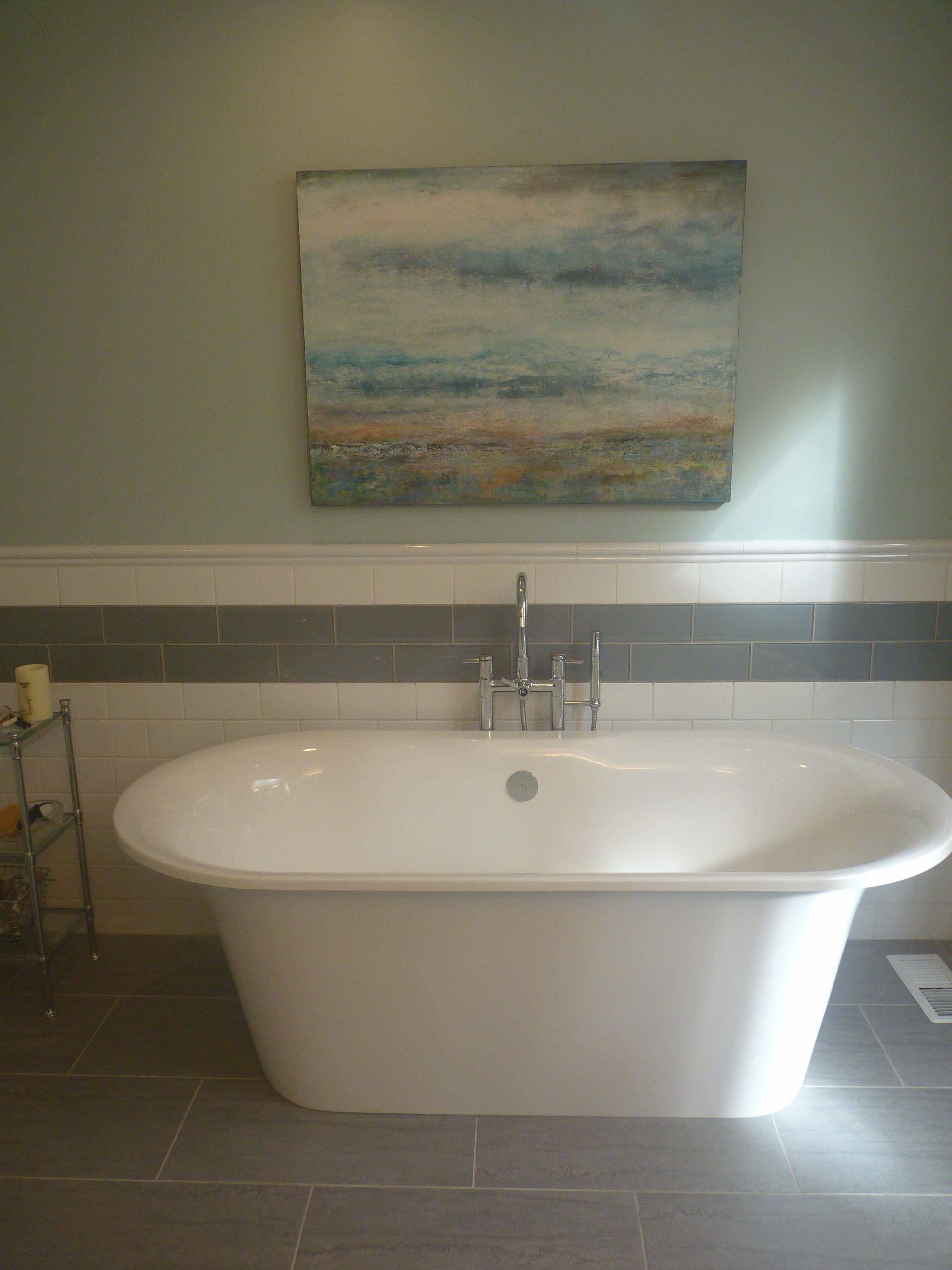 Take a dip in this awesome free standing tub.. Barbara Quast Interior  Design q