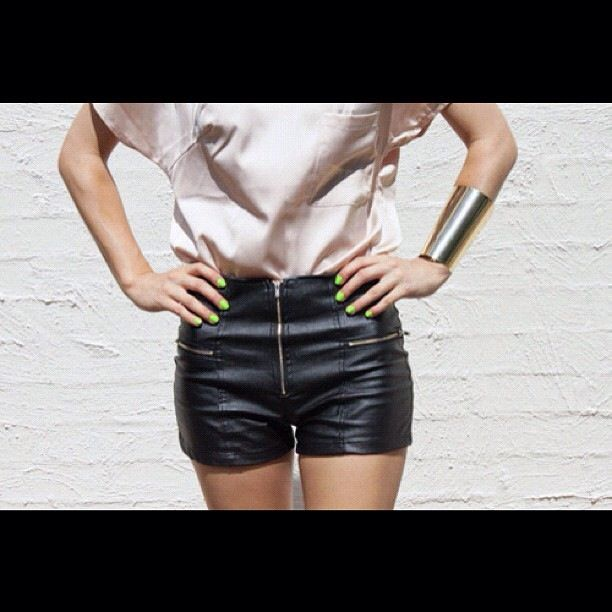 Sexy little black leather shorts.