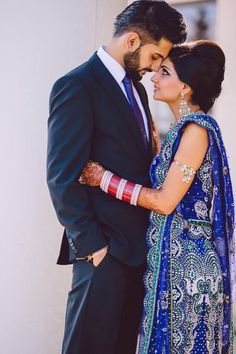 indian couple in blue wedding dress - Google