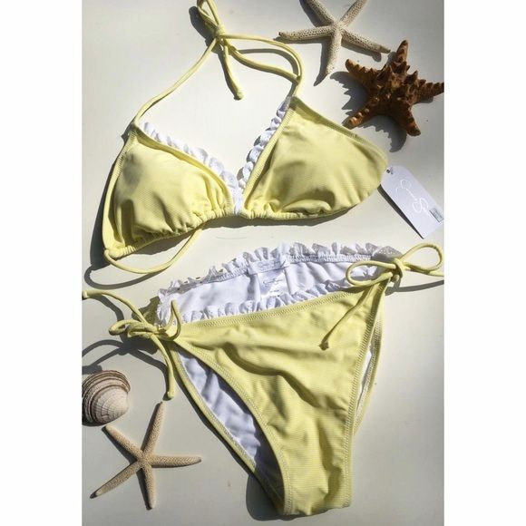 5884c86ba4 Jessica Simpson NWT striped string bikini Cute yellow and white striped  string bikini. Ruffles along triangle top and bottoms. Never worn Jessica  Simpson ...