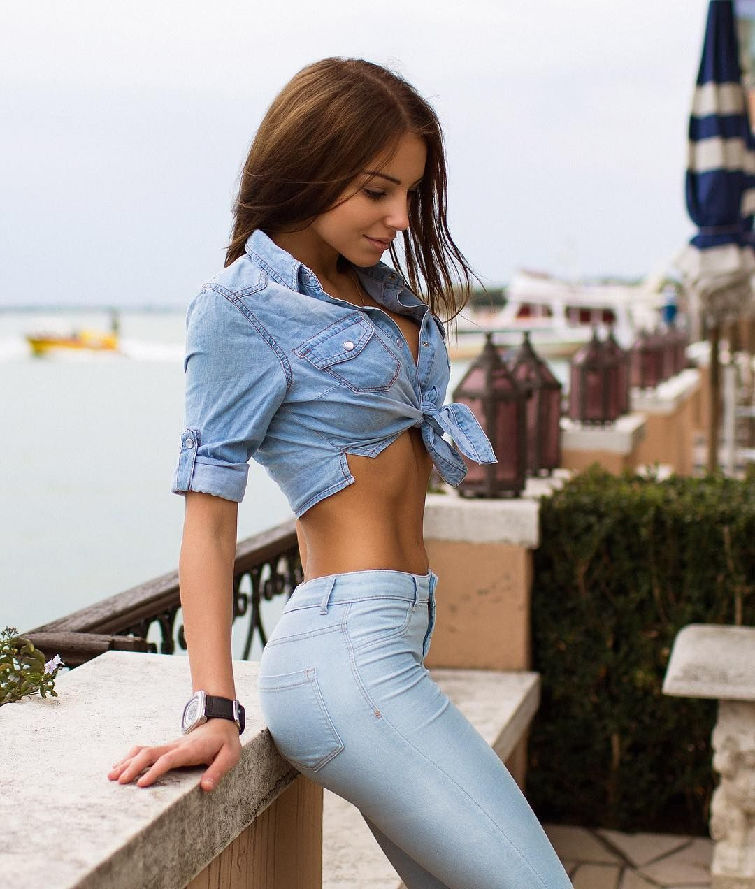 Young Sexy Woman In Blue Jeans Standing Back Looking Sexy By Viktor Solomin