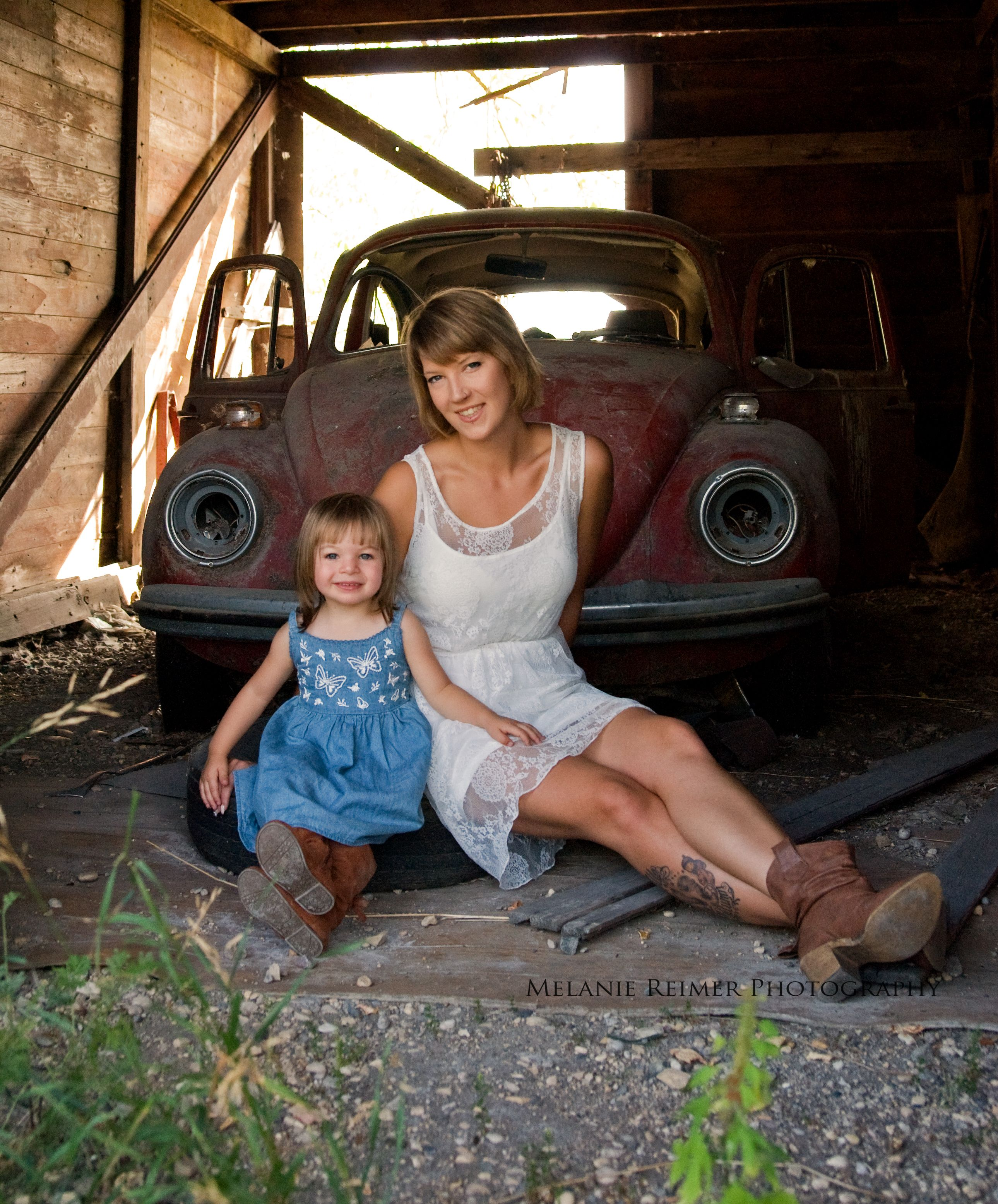 Melanie Reimer Photography   Outdoor summer vintage themed mom and me session. Old car, cowboy boots.