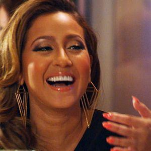 LOVE Adrienne's upside-down pyramid earrings, coral lip gloss and matching nail polish. #StyleNetwork #EmpireGirls