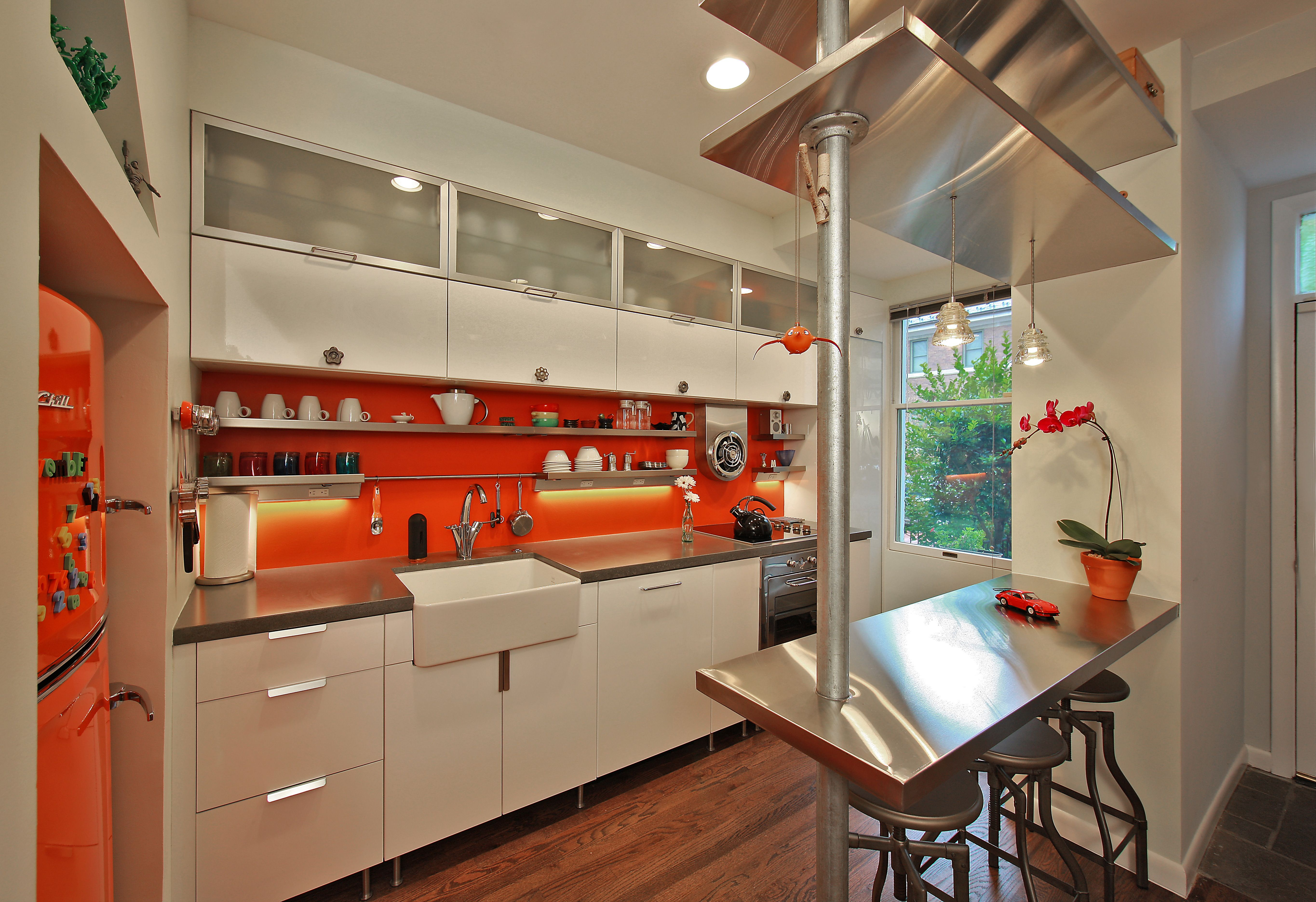 Sweet orange and white kitchen remodel with stainless steel accents ...