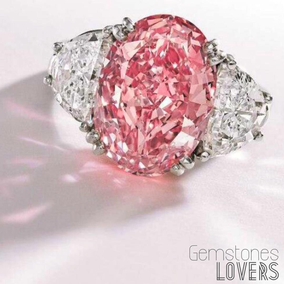 A magnificent 6.54 carat, Fancy Intense Pink diamond ring which sold ...