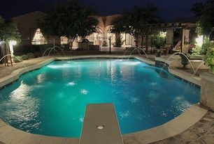 Traditional Swimming Pool with Inground pool, Exterior lights, Diving board, Pool fountain, Wrought iron fencing