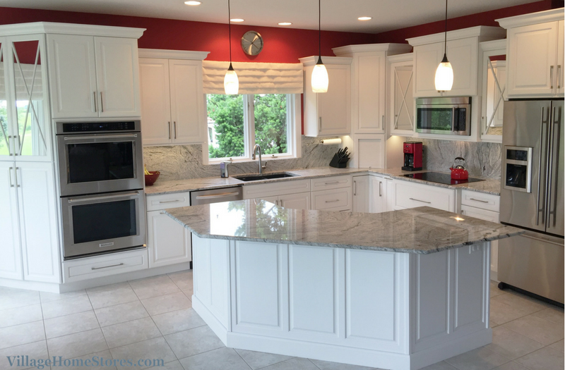 White painted kitchen with full height granite backsplash ...